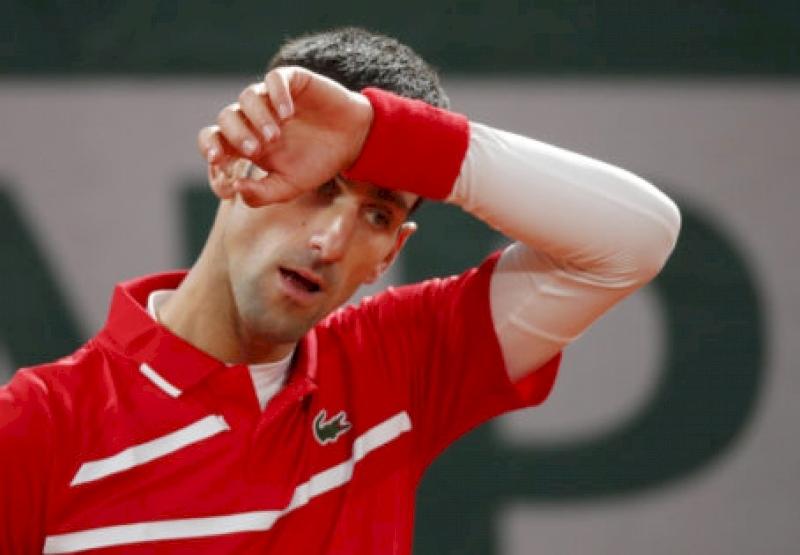 boris-becker-says-match-against-stefanos-tsitsipas-hindered-novak-djokovic's-performance-against-rafael-nadal-at-french-open-2020