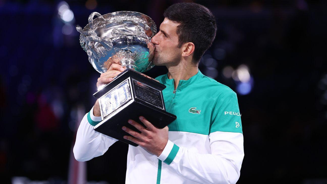 Novak Djokovic kissing his well deserved 2021 Australian Open men's singles trophy